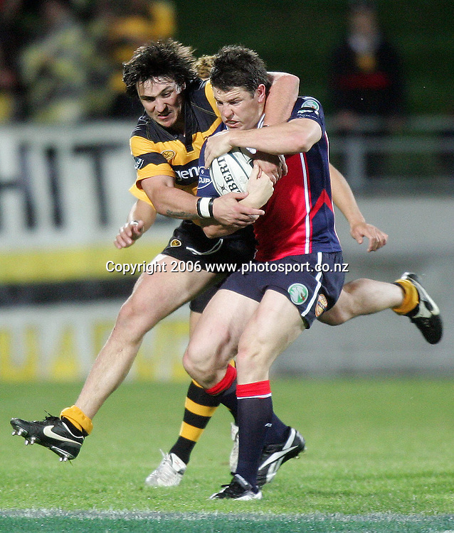 Peter Playford of Tasman gets scragged by Mathew Harvey of Taranaki during the Air NZ Cup rugby match between Taranaki and Tasman at Yarrow Stadium, New Plymouth, New Zealand on Saturday 30 September, 2006. Photo: Marty Melville/PHOTOSPORT