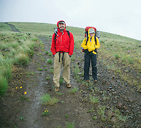 Couple backpacking in a rain storm Umptanum Ridge Washington USA&#xA;<br />