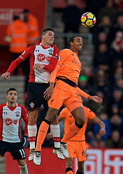 SOUTHAMPTON, ENGLAND - Sunday, February 11, 2018: Liverpool's Joel Matip and Southampton's Guido Carrillo during the FA Premier League match between Southampton FC and Liverpool FC at St. Mary's Stadium. (Pic by David Rawcliffe/Propaganda)