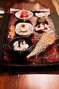 """Hiroshima oyster with lime caviar, roast duck with coffee flavor and anko pepper, curry """"bread"""", deep fried shio negi root (a kind of salt scallion), Japenese corned beef with Tasmanian mustard seed, Fugu (puffer fish) with spicy miso, squid with chili oil. Kahala restaurant."""