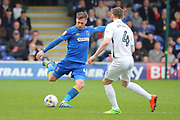 AFC Wimbledon midfielder Dannie Bulman (4) passing the ball during the EFL Sky Bet League 1 match between AFC Wimbledon and Northampton Town at the Cherry Red Records Stadium, Kingston, England on 11 March 2017. Photo by Matthew Redman.