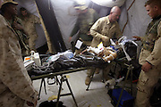 US Marines corpsman try to stabilize a patient who was apparently involved in a auto accident in Tikrit. Many local residents that have a wide range of emergency medical problems as well as being beaten and/or shot are brought to US forces for help. The US Marines who will treat any patient, EPW's as well as civilians regardless of their background or how they were injured. This patient was prepared to be MEDEVACed to a more extensive medical facilities.