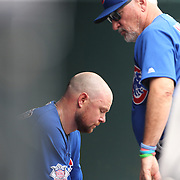 NEW YORK, NEW YORK - July 03: Manager Joe Maddon #70 of the Chicago Cubs consoles pitcher Jon Lester #34 of the Chicago Cubs after he was pulled in the second innings after giving up seven runs during the Chicago Cubs Vs New York Mets regular season MLB game at Citi Field on July 03, 2016 in New York City. (Photo by Tim Clayton/Corbis via Getty Images)