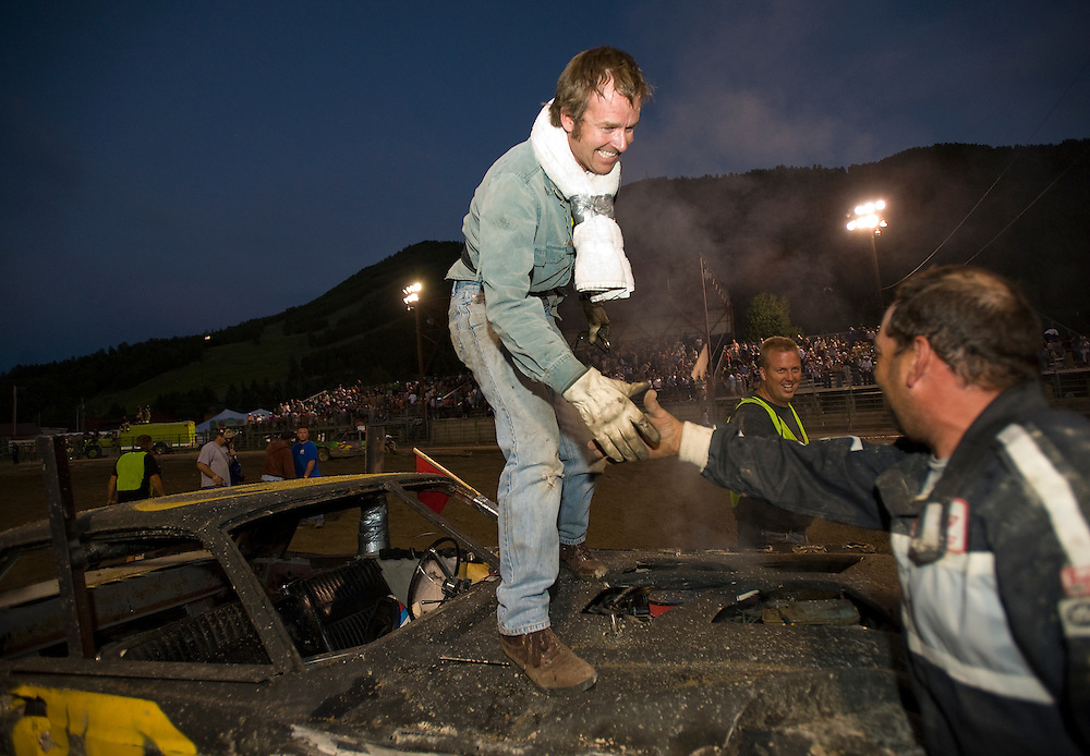 NEWS&GUIDE PHOTO / PRICE CHAMBERS.Demolition derby winner Dan Daniels, of Driggs, shakes hands with Frank Dickman, who placed second. Daniels beat 13 other competitors to claim the title Sunday night.