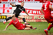 Walsall FC defender Dan Scarr (35) can't stop Barnsley forward Cauley Woodrow getting in a shot during the EFL Sky Bet League 1 match between Walsall and Barnsley at the Banks's Stadium, Walsall, England on 23 March 2019.