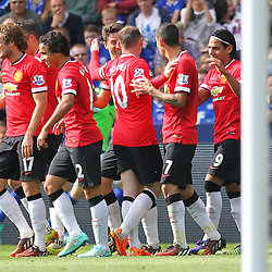 Manchester United players celebrate goal scorer Ander Herrera during the Barclays Premiership match between Leicester City FC and Manchester United FC, at the King Power Stadium, Leicester, 21st September 2014 © Phil Duncan | SportPix.org.uk