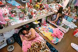 Strippers rest at backstage in Tokyo, Japan May 28, 2005.