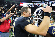 Nov 4, 2018; New Orleans, LA, USA: New Orleans Saints quarterback Drew Brees (9) and Los Angeles Rams wide receiver Brandin Cooks (12) greet each other during postgame at the Mercedes-Benz Superdome. The Saints beat the Rams 45-35. (Steve Jacobson/Image of Sport)