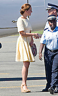 "CATHERINE, DUCHESS OF CAMBRIDGE.was looking tired and not her usual jovial self as the couple departed the Solomon Islands for Tuvalu, the last destination on their Asia-Pacific Tourfrom Honiara Airport_18/09/2012.Clutching a fan and  with hands on her belly Kate looked apprenhensive - was it the closeness of the impending return to the UK and was there another reason..Mandatory credit photo: ©NEWSPIX INTERNATIONAL..(Failure to credit will incur a surcharge of 100% of reproduction fees)..                **ALL FEES PAYABLE TO: ""NEWSPIX INTERNATIONAL""**..IMMEDIATE CONFIRMATION OF USAGE REQUIRED:.DiasImages, 31a Chinnery Hill, Bishop's Stortford, ENGLAND CM23 3PS.Tel:+441279 324672  ; Fax: +441279656877.Mobile:  07775681153.e-mail: info@newspixinternational.co.uk"