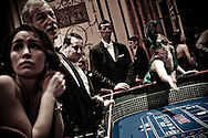 Guests gambling for charity at the The Viennese Opera Ball in New York City. The VOB is the biggest and most famous of New York's charity balls. Held yearly at the Waldorf Astoria hotel and opened by debutantes and their escorts...In New York City separate worlds coexist without necesseraily ever meeting. Some are virtually closed to outsiders...The world of New York's society often meets in the grand ballrooms of the city's most prestigeous hotels, such as The Pierre, The Plaza and The Waldorf Astoria. They meet at big balls to dine, dance and donate money to charity through auctions held at the balls. Parts of the proceeds from tickets, which are in the range of $1000/person, also go to charity.