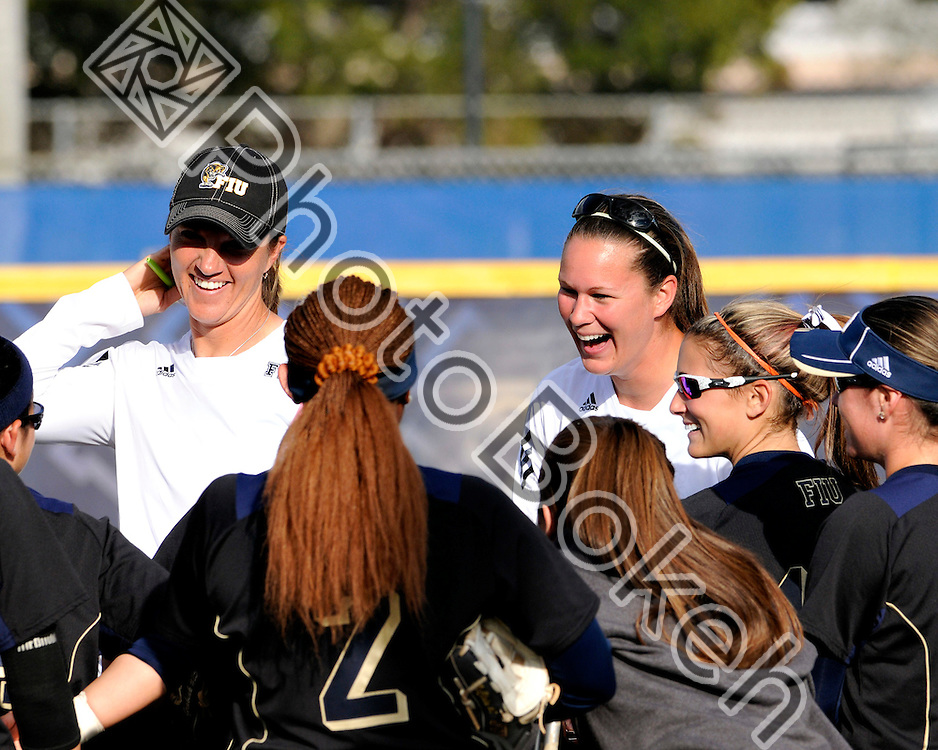 2011 February 13 - Coach Beth Torina and Assistant Coach Megan Higginbotham meeting with their team prior to the game. Florida International University Golden Panthers defeated the North Florida Ospreys, 3-0, at the FIU Softball Complex as part of the season opening Combat Classic, Miami, Florida.