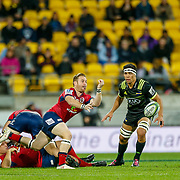 Ben Lucas pass the ball during the Super rugby union game (Round 14) played between Hurricanes v Reds, on 18 May 2018, at Westpac Stadium, Wellington, New  Zealand.    Hurricanes won 38-34.