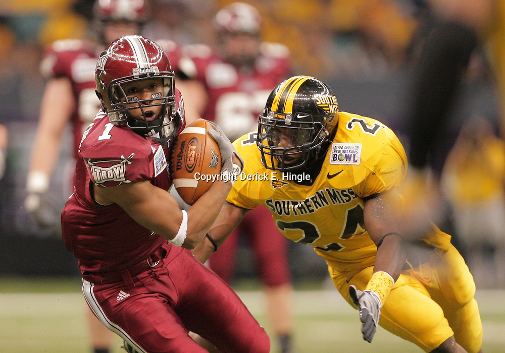 21 December 2008:  Troy wide receiver Cornelius Williams (1) runs away from Southern Miss linebacker Gerald McRath (24) during a 30-27 overtime victory by the Southern Mississippi Golden Eagles over the Troy Trojans in the  R+L Carriers New Orleans Bowl at the New Orleans Superdome in New Orleans, LA.