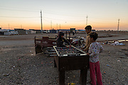 Children play table football in Baharka camp