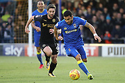 AFC Wimbledon striker Andy Barcham (17) taking on \ww9 during the EFL Sky Bet League 1 match between AFC Wimbledon and Wigan Athletic at the Cherry Red Records Stadium, Kingston, England on 16 December 2017. Photo by Matthew Redman.