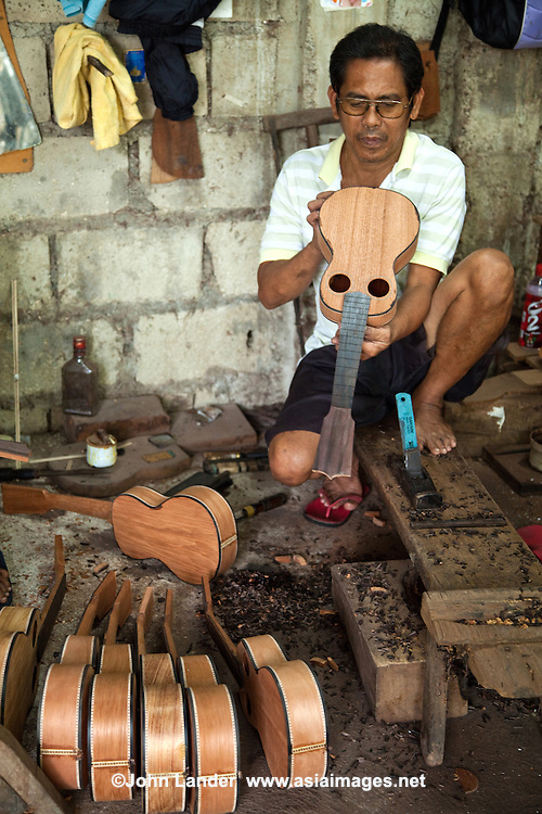 "Though pre-colonial Visayans had a variety of string instruments which used a coconut shell or gourd as resonator - the guitar is a Spanish introduction. Guitars have been made in Cebu since the Spanish period mainly as a areplacement for organs for church music until they were later imported. Yet, guitars  developed as a local industry only in the present century, receiving a boost from the government's promotion of cottage industries in the immediate postwar period. In Mactan, the craft of guitar making passes from generation to generation and the industry involves many families, the most prominent of whom is the Alegre and Malingin families whose names have become well-known ""brand names"" of Mactan or Cebu guitars."