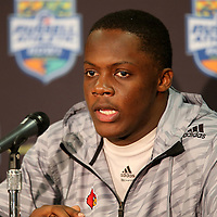 Louisville Cardinals quarterback Teddy Bridgewater speaks with the media about his future with Louisville after the NCAA Football Russell Athletic Bowl football game between the Louisville Cardinals and the Miami Hurricanes, at the Florida Citrus Bowl on Saturday, December 28, 2013 in Orlando, Florida. Louisville won the game by a score of 36-9, and as of today, Bridgewater is undecided on his return to the team. (AP Photo/Alex Menendez)