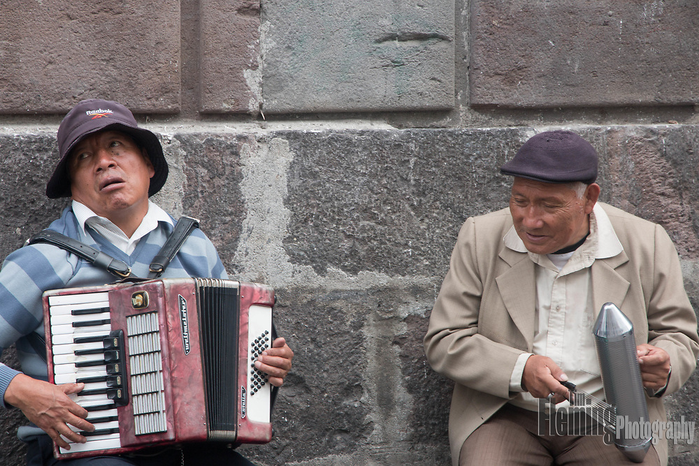 Two men playing music on the streets of Quito, Ecuador.