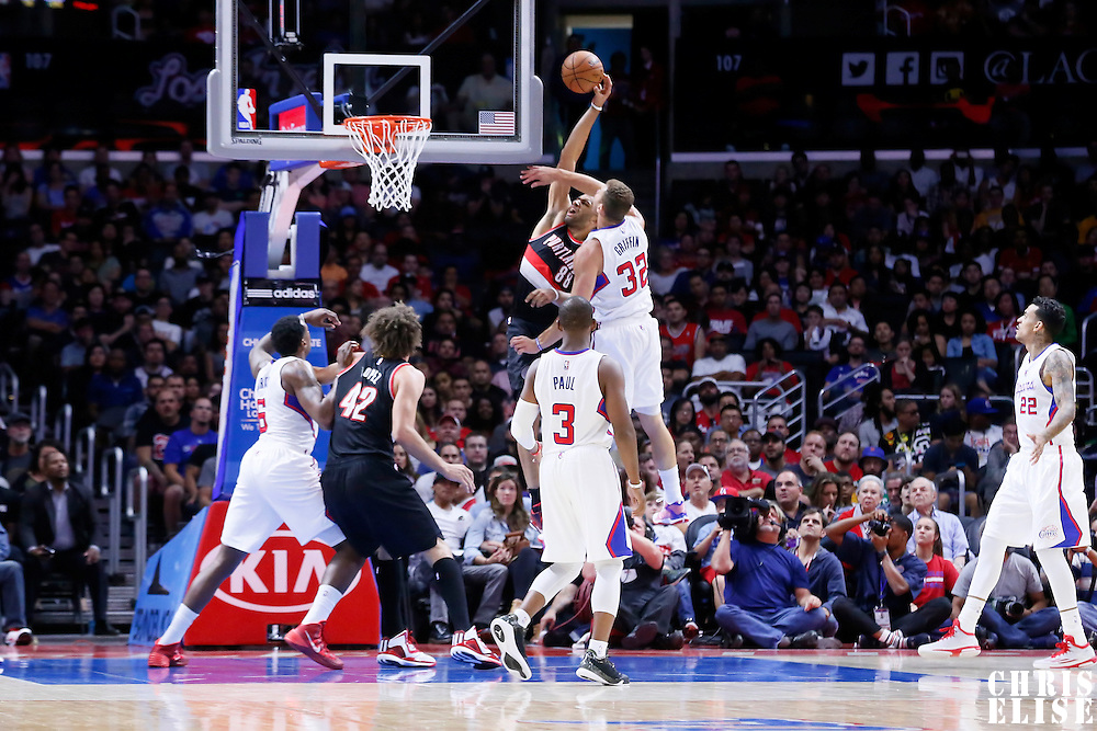 08 November 2014: Portland Trail Blazers forward Nicolas Batum (88) goes for the dunk over Los Angeles Clippers forward Blake Griffin (32) during the Los Angeles Clippers 106-102 victory over the Portland Trail Blazers, at the Staples Center, Los Angeles, California, USA.