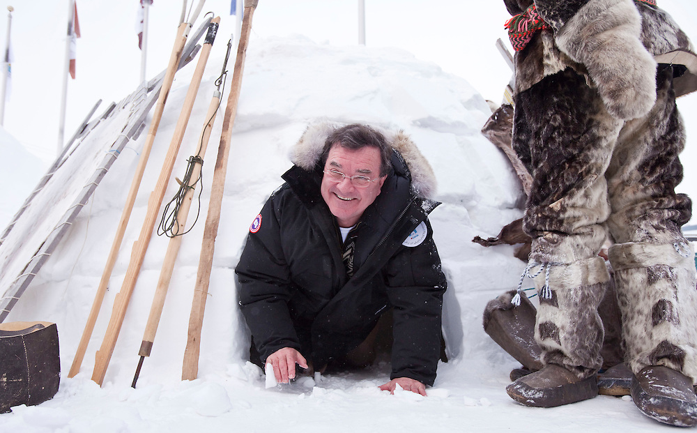 Canada's Finance Minister Jim Flaherty sucessfully exits an igloo outside the Nunavut legislature in Iqaluit, Canada during a break in proceedings at the G7 Finance Ministers Meeting, February 6, 2010. Moments earlier Minister Flaherty dislodged a large piece of snow from the entry way of another smaller igloo as he attempted to exit.<br /> AFP/GEOFF ROBINS/STR<br /> <br /> Note corrected spelling of Iqaluit