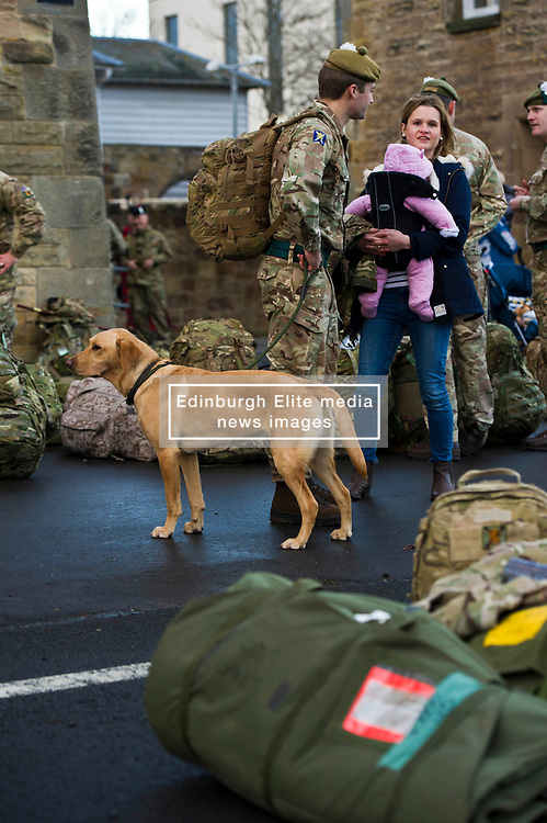 Pictured: Captain Graham, wife Sophie holding duaghter Emilie alongside dog Buddy<br /> Glencouirse Barracks saw off 100 soldiers from 2 SCOTS today as they prepared to deploy to Iraq on a six month training and mentoring mission. The soldiers will deploy on what is known as Operation Shader, on a six month tour which is a different challenge from their previous combat roles in the country. Just over 100 personnel will depart from Glencorse, to join the advance party which is already in the country.<br /> <br /> Ger Harley | EEm 4 December 2017