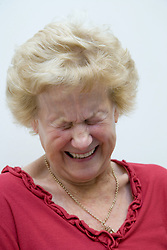 Portrait of a lady laughing at the Nottingham Royal Society for the Blind (NRSB),