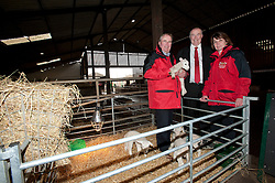 Pictured is, from left, Rand Farm Park owner Richard Waring, Clydesdale Bank commercial relationship manager Michael Pickles and Rand Farm Park owner Kay Waring with a new born lamb<br /> <br /> Clydesdale Bank - Rand Farm Park<br /> <br /> March 27, 2015