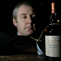 FREE TO USE PIC...Derek Brown, Director of the Famous Grouse Experience in Crieff with a bottle of 1972 limited edition Glenturret whisky, one of the rare whiskies on sale in the March Madness cellar sale.<br />for further info contact Carol McLaren on 01738 493777<br /><br />Picture by Graeme Hart<br />Perthshire Picture Agency<br />Tel: 01738 623350 / 07990 594431