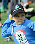 Cricket fan looks to throw the ball at the National Bank's Cricket Super Camp , University oval, Dunedin, New Zealand. Thursday 2 February 2012 . Photo: Richard Hood photosport.co.nz