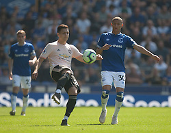 Diogo Dalot of Manchester United (C) and Richarlison of Everton in action - Mandatory by-line: Jack Phillips/JMP - 21/04/2019 - FOOTBALL - Goodison Park - Liverpool, England - Everton v Manchester United - English Premier League