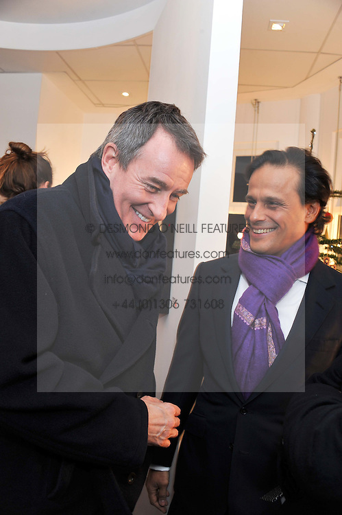 Left to right, TIM JEFFERIES and ARUN NAYER at a private view of photographs by Anthony Souza held at The Little Black Gallery, 13A Park Walk, London SW10 on 13th December 2011.