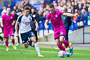 Rochdale defender Rhys Norrington-Davies tackled by the opponent during the EFL Sky Bet League 1 match between Bolton Wanderers and Rochdale at the University of  Bolton Stadium, Bolton, England on 19 October 2019.