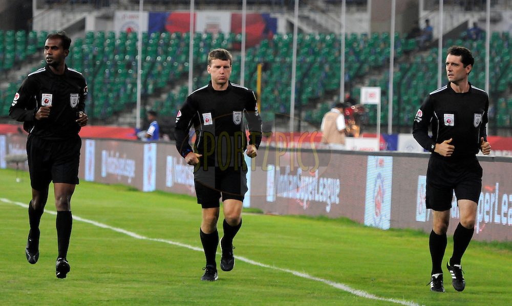 Referees are seen warming up before the start of match 15 of the Hero Indian Super League between Chennaiyin FC and Mumbai City FC held at the Jawaharlal Nehru Stadium, Chennai, India on the 28th October 2014.<br /> <br /> Photo by:  Pal Pillai/ ISL/ SPORTZPICS