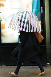 © Licensed to London News Pictures. 05/10/2015. Manchester, UK. After a beautiful sunny day yesterday the week starts with wind and rain. Photo credit: Graham M. Lawrence/LNP