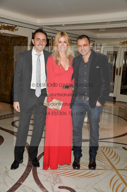 Left to right, NICOLAS DE SANTIS, MELISSA ODABASH and GERRY DEVEAUX at a birthday dinner for Claire Caudwell for family & friends held at The Dorchester, Park Lane, London on 24th January 2014.