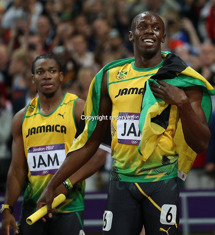 11.08.2012. London, England. xxx Olympic Games London 2012 4x100m for men. Blake Yohan Bolt Usain Jam  cheering with their national flag