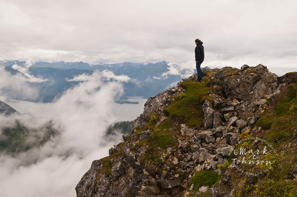 Woman admiring the view of Sitka Sound from Harbor Mtn., Sitka, Alaska