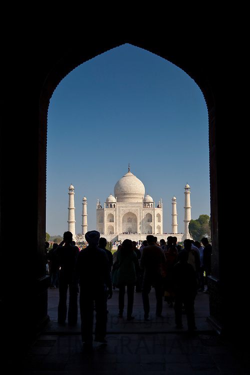 Crowd of tourists framed by The Great Gate, Darwaza-i rauza, of The Taj Mahal view southern aspect, Uttar Pradesh, India