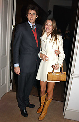 MISS AMANDA SHEPPARD and MR RICHARD O'HAGAN at a party to celebrate the 4th anniversary of Quintessentially held at 11 Grosvenor Place, London  SW1 on 14th December 2004.<br />