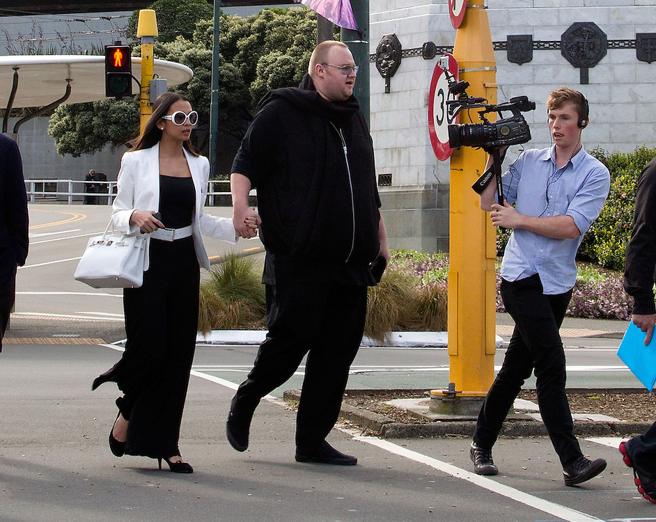 Kim Dotcom with his wife Mona are followed by media as they leave Parliament grounds after watching question time at Parliament, Wellington, New Zealand, Wednesday, September 19 2012. Credit: SNPA / Marty Melville