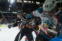 KELOWNA, CANADA - FEBRUARY 28: Adam Tambellini #19 of Calgary Hitmen checks Chance Braid #22 of Kelowna Rockets into the boards during first period on February 28, 2015 at Prospera Place in Kelowna, British Columbia, Canada.  (Photo by Marissa Baecker/Shoot the Breeze)  *** Local Caption *** Adam Tambellini; Chance Braid;