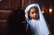 16 JANUARY 2002, GUANAJUATO, GUANAJUATO, MEXICO: A girl dresses as the Virgin of Guadalupe waits for a special mass honoring the Virgin of Guadalupe to start Templo de Pardoe Catholic  in the city of Gunajuato, state of Guanajuato, Mexico, Jan. 16, 2002. .PHOTO BY JACK KURTZ