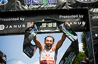 JEROME A. POLLOS/Press..Victor Zyemtsev celebrates his first place finish Sunday of Ironman Coeur d'Alene with a time of 8:33:32. It is the second time Zyemtsev has won the event. The Ukranian set the course record in 2005 with a time of 8:23:29.