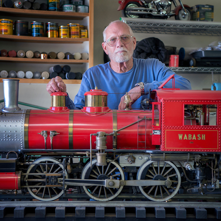 em042117m/living/Jack Harris poses with his fully working 500 lb. model of a F4 Walbash steam engine. The train is in his workshop at him home in Santa Fe, Friday April 21, 2017. (Eddie Moore/Albuquerque Journal