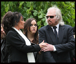 Barry Gibb holds the hand of his wife Linda  at  the funeral of his brother Robin Gibb in Thame, Oxfordshire, Friday, 8th June  2012  Photo by: Stephen Lock / i-Images