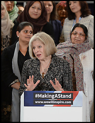 ©Licensed to i-Images Picture Agency. 24/09/2014. London, United Kingdom. The Home Secretary<br /> Theresa may delivers a speech to launch the #makingastand-British Muslim Women New Campaign Against ISIS at Rusia, London. Picture by Andrew Parsons / i-Images