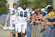 Aug 6, 2018; Costa Mesa, CA, USA: Los Angeles Chargers tackle Trent Scott (68) and offensive lineman Zack Golditch (65) are greeted by fans during training camp at the Jack. R. Hammett Sports Complex.