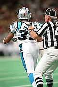 A Referee holds back Darren Hambrick (35) of the Carolina Panthers during a fight with Wide Receiver Isaac Bruce of the St. Louis Rams during a 48 to 14 win by the Rams on 11/11/2001..©Wesley Hitt/NFL Photos