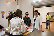 Stephany Lee (from left) and Brigg McDonald are all smiles as their get their certificate of marriage from Linn County clerk Mary Hall (back towards camera) at Linn County West in Cedar Rapids on Monday, April 23, 2012.