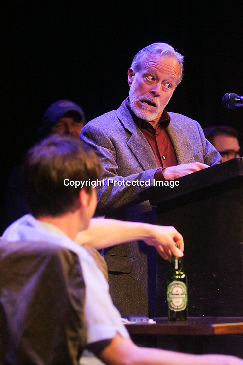 Tom Briggs speaks Sunday March 8, 2015 during A Roast of John Staton, a benefit for Susan Auten at TheatreNOW in Wilmington, N.C. (Jason A. Frizzelle)